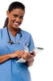 Female physician browsing on tablet pc Stock Photography