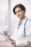 Female physician doing paperwork in hospital Royalty Free Stock Photos