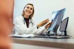 Female physician explaining medical scan result to patient Stock Image