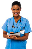 Female physician holding tablet pc Stock Images