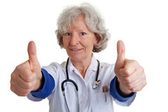 Female physician holding thumbs up Stock Photography