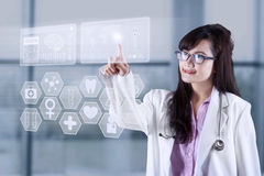 Female physician with modern technology Stock Images