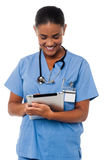 Female physician operating tablet pc Royalty Free Stock Images