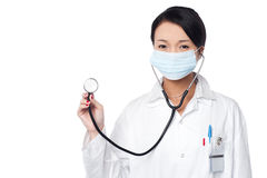 Female physician posing with stethoscope Stock Photography