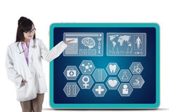 Female physician showing medical symbols Stock Photo