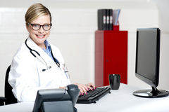 Female physician using computer Stock Photography