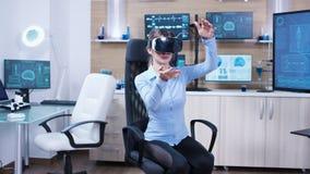 Female physician using virtual reality goggles in a futuristic clinic