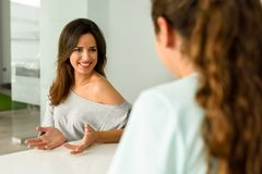 Female physiotherapist explaining diagnosis to her woman patient. royalty free stock photos