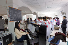 Female pianist and choir Stock Image
