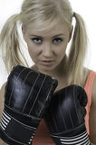 Female with pig tails boxing. Blond female with pigtails ready to box royalty free stock photo