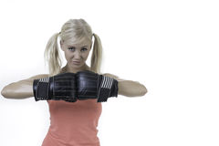 Female with pig tails boxing. Blond female with pigtails ready to box royalty free stock photos