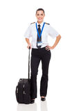 Female pilot briefcase. Beautiful woman airline pilot with briefcase standing on white background royalty free stock images