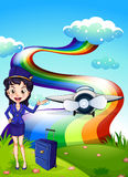 A female pilot at the hilltop with a plane and a rainbow Royalty Free Stock Images