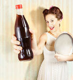 Female pin-up waiter serving drink at summer party Stock Photo