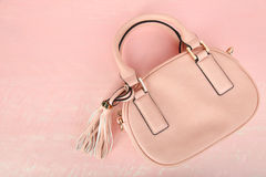 Female pink bag. On a pink background Stock Photography