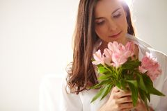 Female with pink flowers Royalty Free Stock Photo