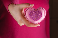 Female in pink give soft heart. Romantic concept. Female in pink give soft heart symbol royalty free stock photos