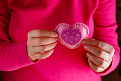 Female in pink give soft heart. Romantic concept. Female in pink give soft heart symbol stock image