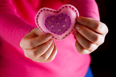 Female in pink give soft heart. Romantic concept. Female in pink give soft heart symbol royalty free stock photo