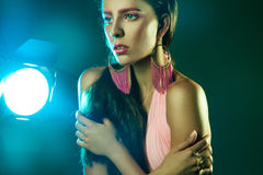 Female with pink make up looking away in studio Stock Photo