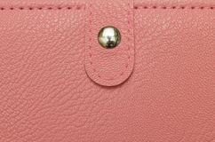 Female pink purse texture Stock Image
