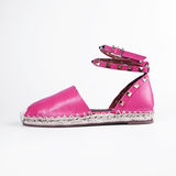 Female pink shoes over white Stock Photography