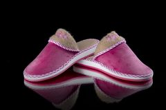 Female Pink Slipper on Black Background, isolated product. Comfortable footwear Stock Photos