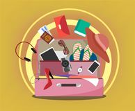 Female pink suitcase with travel items and stylized sun behind stock illustration