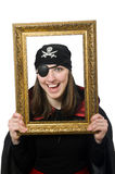 Female pirate in black coat holding photo frame royalty free stock photography