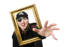 Female pirate in black coat holding photo frame Stock Images