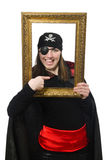 Female pirate in black coat holding photo frame Stock Photography
