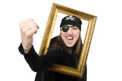Female pirate in black coat holding photo frame stock photo