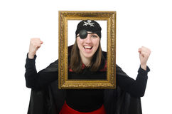 Female pirate in black coat holding photo frame Royalty Free Stock Photo