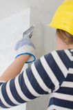 Female plasterer repairs wall Stock Photo