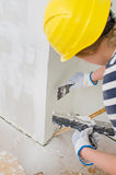 Female plasterer repairs wall Royalty Free Stock Photography