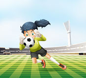 A female player catching the soccer ball Stock Photos
