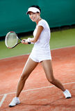 Female player at the clay tennis court Stock Photos