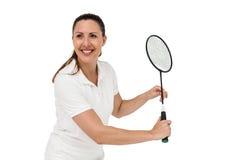 Female player playing badminton Royalty Free Stock Photo