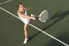 Female Player On Tennis Court Royalty Free Stock Photos