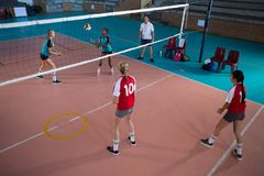 Female players playing volleyball in the court Royalty Free Stock Photos