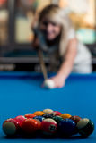 Female Playing Billiard Stock Images