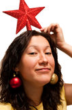 female playing with christmass decorations Stock Image