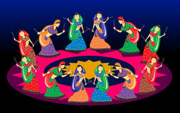 Female playing dandiya on Navratri Garba dance in photo Stock Photography