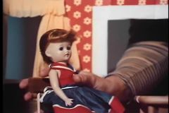 Female playing with dolls in dollhouse stock video