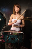 Female playing drums Royalty Free Stock Photography