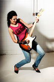 Female playing electric guitar stock photo