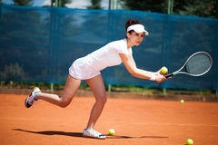 Female playing tennis Royalty Free Stock Images