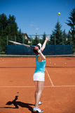 Female playing tennis Stock Photography