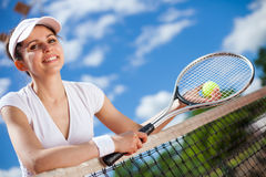 Female playing tennis Stock Images