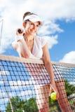Female playing tennis Stock Photo